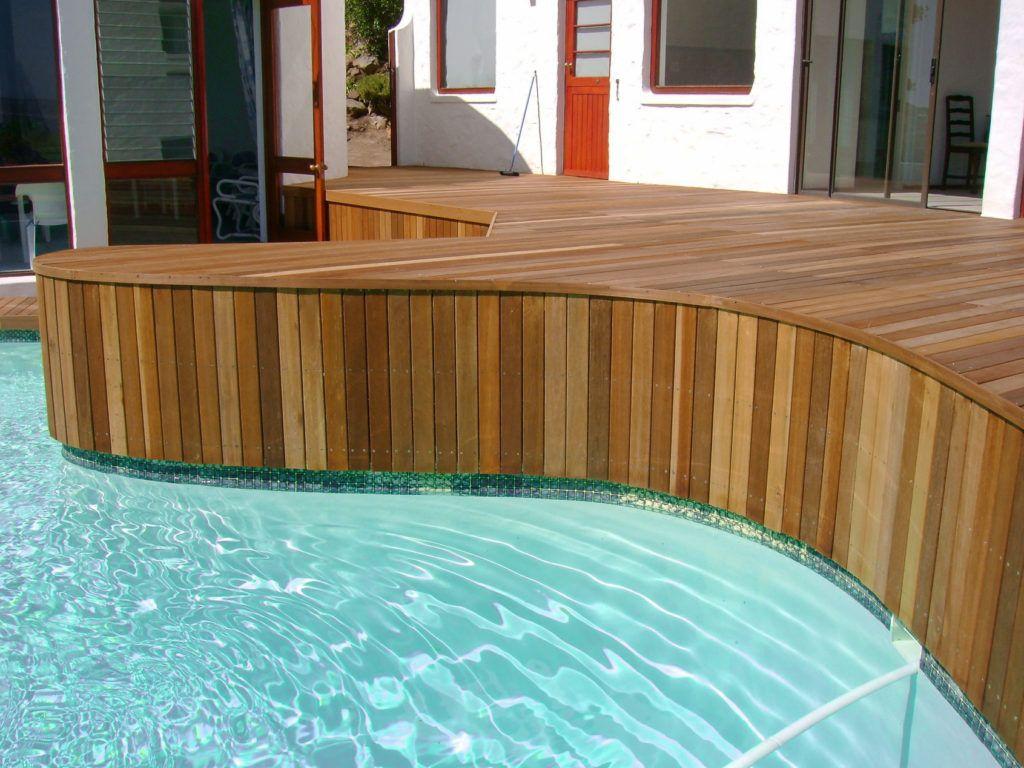Wooden cladding around pool
