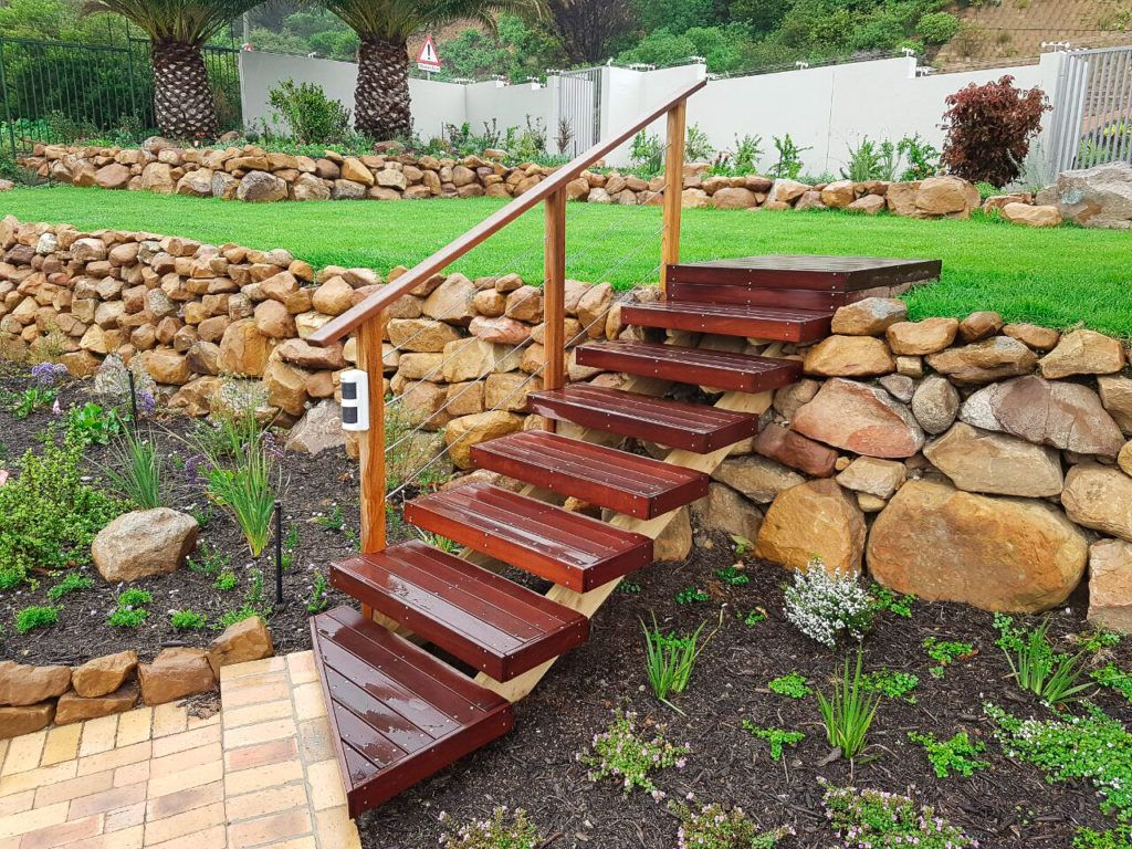 Timber staircase in garden to connect levels